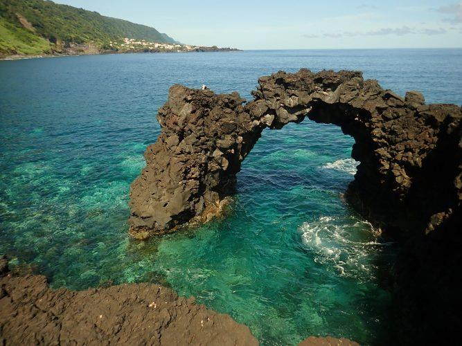 One of the many natural arches along the north side of the island of São Jorge, Açores. - photo © Rod Morris