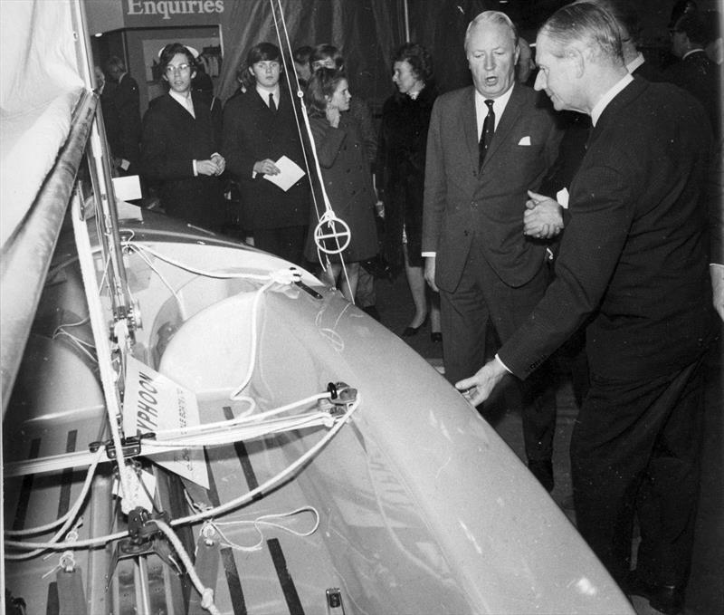 Jack Chippendale (sandwiched between Prince Philip and Edward Heath) demonstrates many of the innovative features of the new Typhoon dinghy. Sadly, the boat, which was years ahead of it's time, would fail to save the fortunes of the Chippendale Boatyard - photo © Chippendale