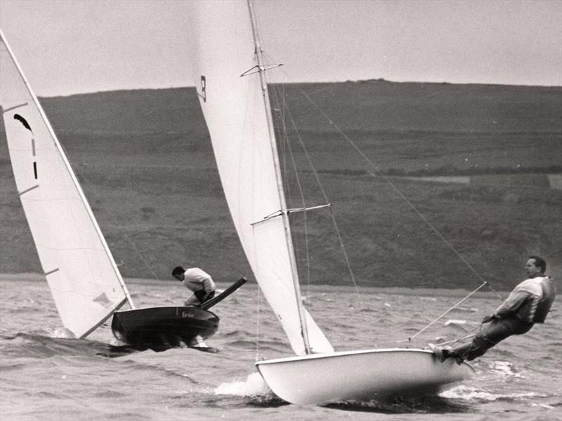 The present is shown the future!  Jack Holt's first entry for Weymouth, the pretty (but only 14ft long) Cavalier, complete with sliding seat, was outclassed by Paul Elvstrom on his Trapez - photo © David Thomas