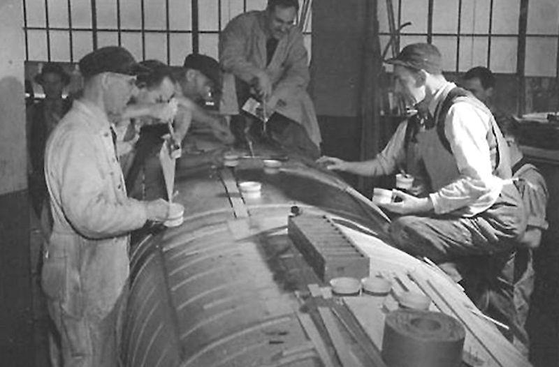The first stage of manufacture as layers of lightweight beech ply are glued before being laid up over the mould photo copyright Fairey Aviation taken at  and featuring the Classic & Vintage Dinghy class