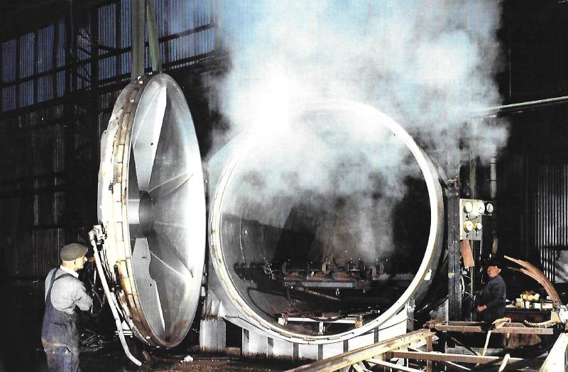 Opening up the autoclave with the steamed wooden structure inside, sheathed in rubber - photo © G Currey