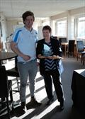 Paul Grattage is presented the Chris Black Trophy by Judith Black