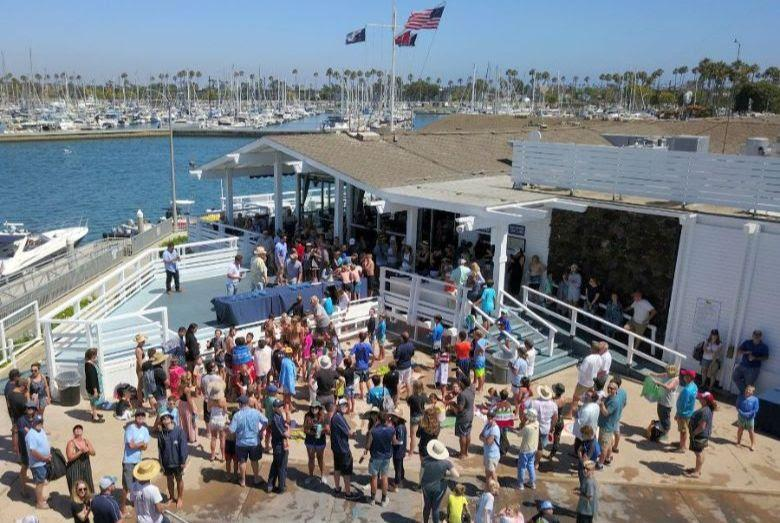 A crowd gathers for the presentation of the Jessica Uniack Memorial Trophy, awarded to the winning sailing of the largest fleet. - photo © Cameron MacLaren