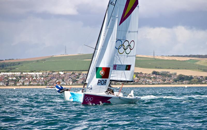Racing off the beach opposite the 2012 Olympic Regatta venue on Weymouth Bay. A Sailing Venue with a Beach Hub and Marina Hub is not practical because of the distances and travel time involved. - photo © Richard Gladwell