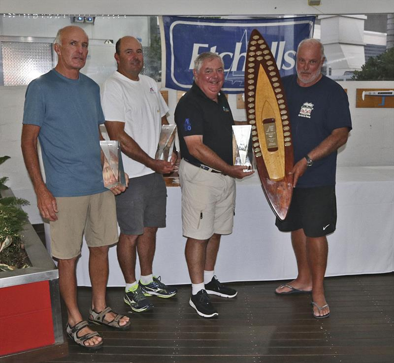 RQYS Commodore presents Iain Murray, Richie Allanson and Colin Beashel with their loot for winning the 2019 Etchells Australian Championship photo copyright John Curnow taken at Royal Queensland Yacht Squadron and featuring the Etchells class