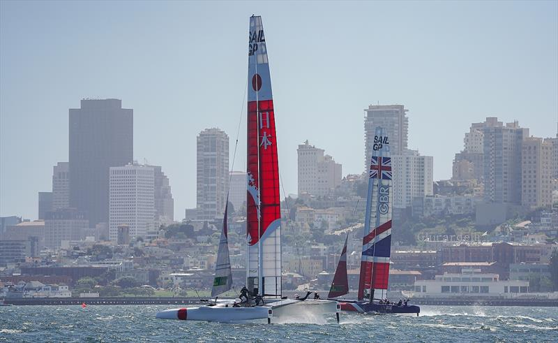 Great Britain SailGP Team skippered by Dylan Fletcher and Japan SailGP Team skippered by Nathan Outteridge raining on choppy waters in the bay. Race 2 Season 1 SailGP event in San Francisco, California,  - photo © Beau Outteridge for SailGP