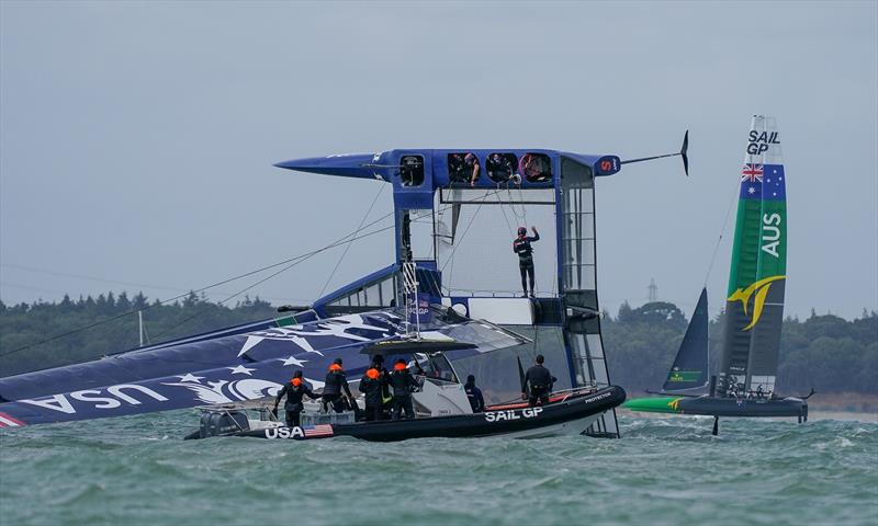 United States SailGP Team F50 catamaran capsized during the first race in high winds on Race Day. Event 4 Season 1 SailGP event in Cowes, Isle of Wight, England, United Kingdom. - photo © Bob Martin for SailGP