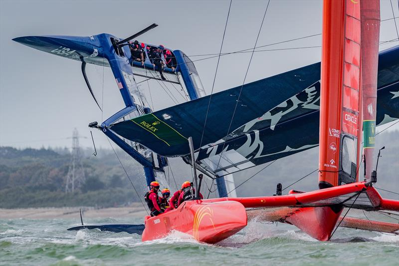 China SailGP Team sails past as the United States SailGP Team's F50 capsizes slowly after a turn during race one. Race Day - Cowes, Day 2, August 11, 2019 - photo © Ian Roman for SailGP