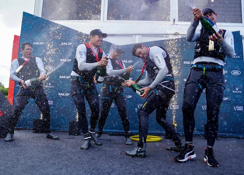 Australia SailGP Team helmed by Tom Slingsby spray Taittinger champagne on stage after winning Cowes SailGP. - Cowes, Day 2, August 11, 2019 - photo © Bob Martin for SailGP