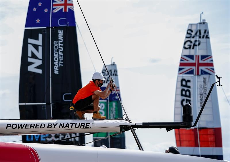 A member of the Japan SailGP Team make adjustments to their team F50 after it has been craned onto the water on Race Day 2 at the Cross Island Technical Base.  - photo © Thomas Lovelock/SailGP