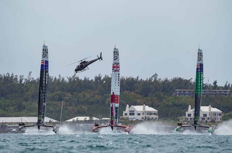 New Zealand SailGP TeamGreat Britain SailGP  and Australia SailGP Team helmed by Tom Slingsby racing in a line on Race Day 2. Bermuda SailGP  - photo © Bob Martin/SailGP
