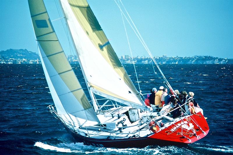 Mike Clark at the starboard quarter, talking to helmsman Graeme Woodroffe, as Exador leads the fleet into the Rangitoto Channel - New Zealand Admirals Cup Trials in 1985 - photo © Peter Montgomery