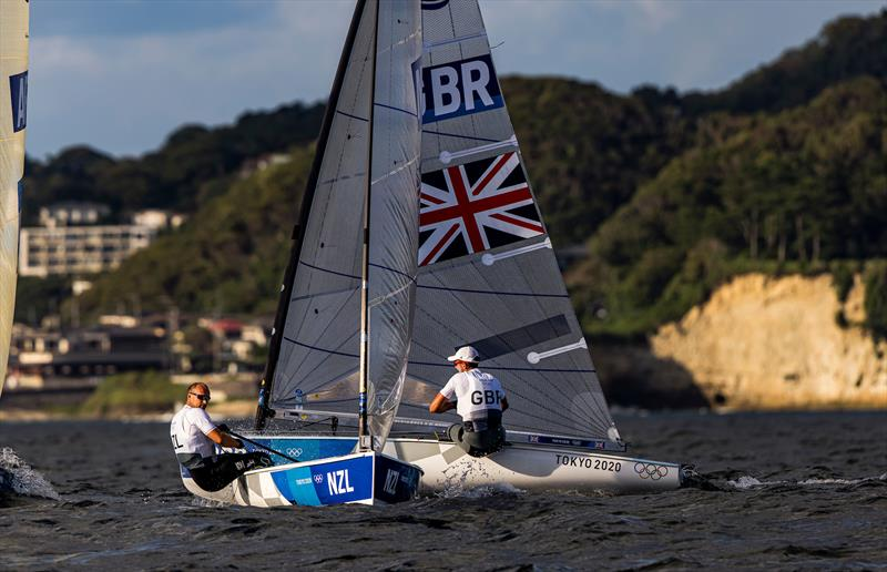 Josh Junior (NZL) crossed Giles Scott (GBR) on Tokyo 2020 Olympic Sailing Competition Day 3 - photo © Sailing Energy / World Sailing