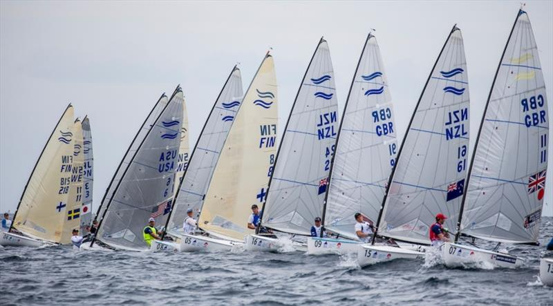Finn fleet on Day 3 at World Cup Series Enoshima - photo © Jesus Renedo / Sailing Energy / World Sailing