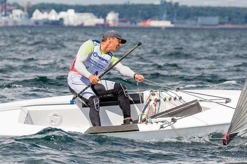 A Finn sailor grunts his boat downwind at the 2018 Hampel World Championships in Aarhus - photo © Robert Deaves / IFA