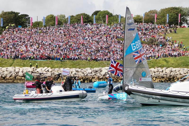 Now INEOS Team UK skipper Ben Ainslie, acknowledges the crowd on The Nothe, at the Weymouth Olympics 2012, where he won his fourth Olympic Gold medal photo copyright Richard Gladwell / Sail-World.com taken at Royal New Zealand Yacht Squadron and featuring the Finn class