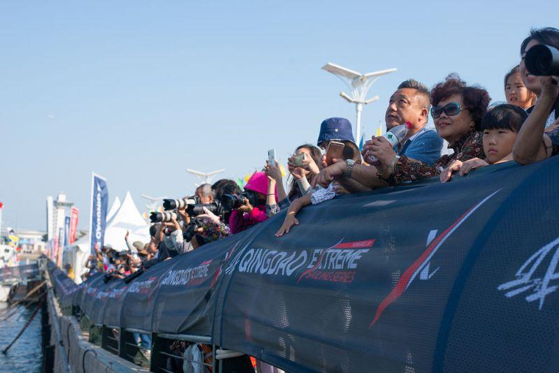 Spectators watched the foiling spectacle from the shore as the fleet of 12 Flying Phantoms battled it out in Fushan Bay, Qingdao - Day 4 - Extreme Sailing Series Qingdao Mazarin Cup - photo © Patrick Condy