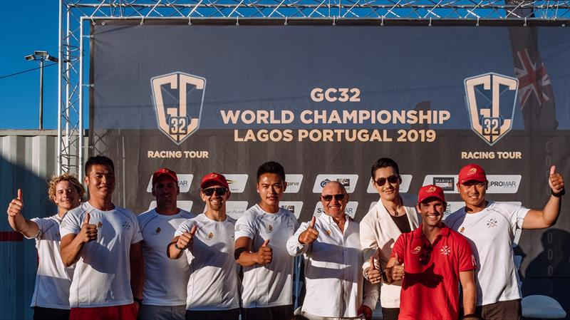 Mr Hu Bing with the ChinaOne.Ningbo team during the GC32 World Championship in Lagos, Portugal - photo © Drew Malcolm / ChinaONE.Ningbo