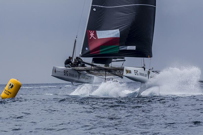 Oman Air on fire coming into the leeward gate - 2019 GC32 Racing Tour - Villasimius Cup - photo © Sailing Energy / GC32 Racing Tour