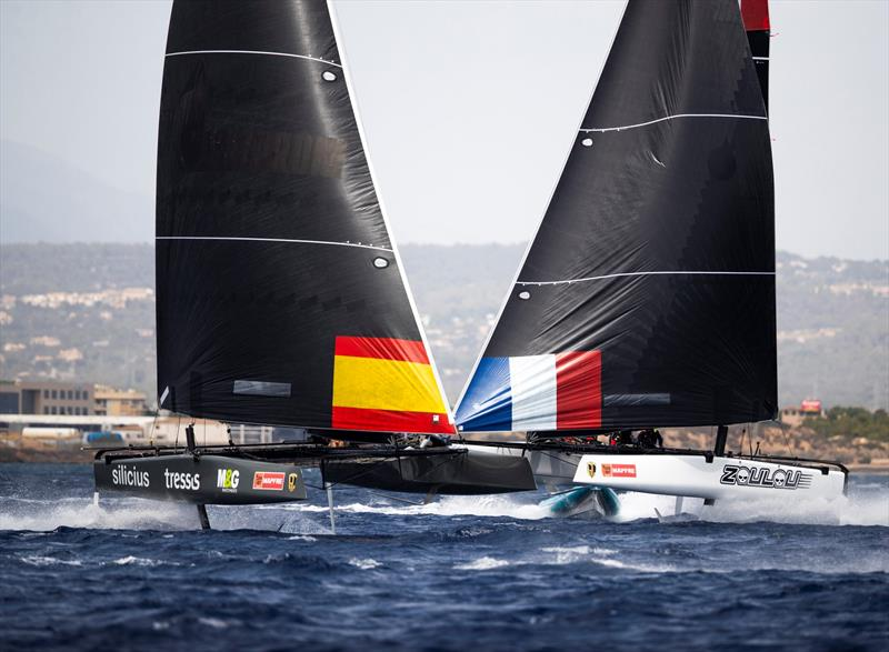 The Iker Martinez-steered M&G Tressis Silicius crosses ahead of Erik Maris' Zoulou. - 38 Copa del Rey MAPFRE photo copyright Sailing Energy / GC32 Racing Tour taken at Real Club Náutico de Palma and featuring the GC32 class