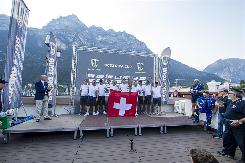 Alinghi receive their GC32 Riva Cup winner's trophy.  - photo © Sailing Energy / GC32 Racing Tour