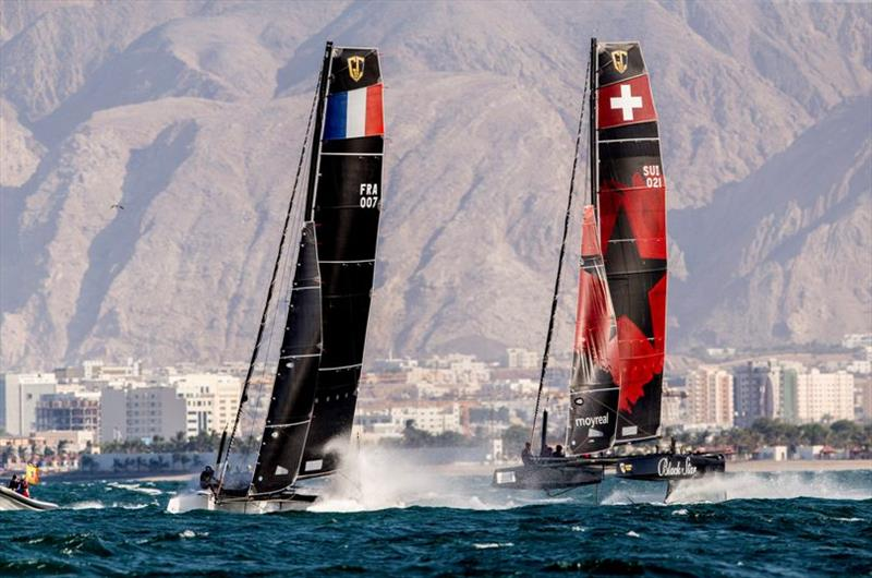 Erik Maris' Zoulou leads Black Star Sailing Team on to the run - GC32 Oman Cup day 3 photo copyright Sailing Energy / GC32 Racing Tour taken at  and featuring the GC32 class