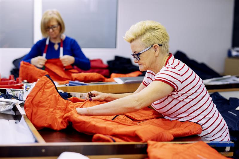 Working on the Mav HL Liner Hood Jacket at the Henri-Lloyd factory in Poland - photo © Henri-Lloyd