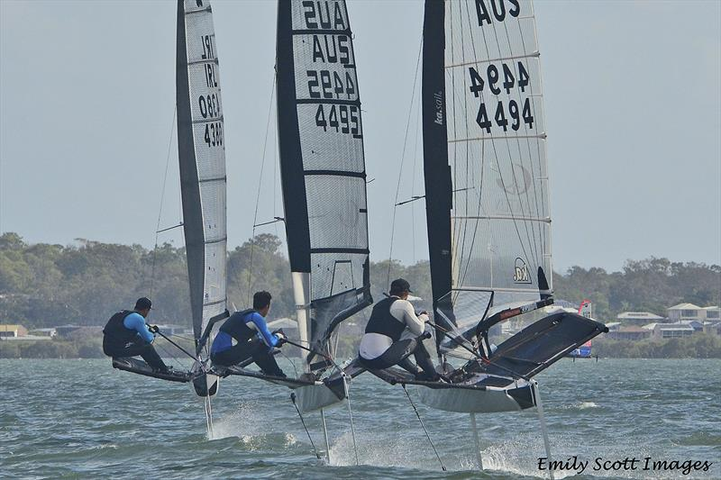 Matthew Chew being chased down by Reese Tailby and Josh McKnight photo copyright Emily Scott Images taken at Royal Queensland Yacht Squadron and featuring the International Moth class