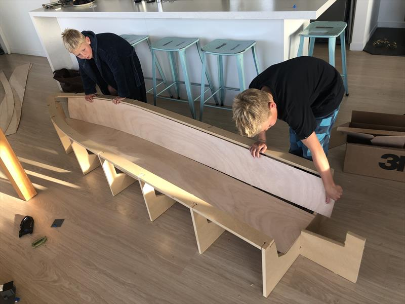 Will and Jonty Leech assembling the hull jig and see how the hull panels fit before bedtime. The project did get taken down to the workshop after this! - photo © Dan Leech