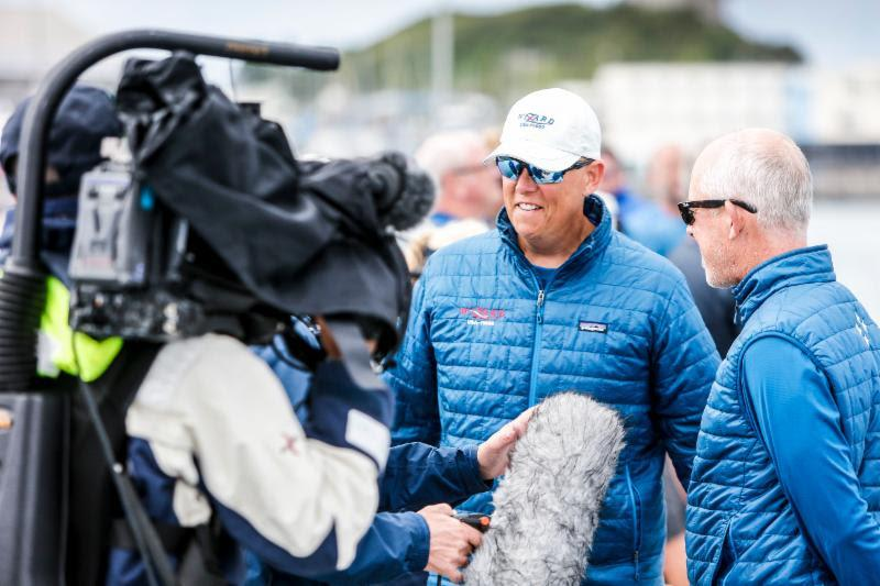 David and Peter Askew hit the dock for some interviews after winning yet another offshore classic yacht race with their VO70 Wizard - photo © RORC / Paul Wyeth / www.pwpictures.com