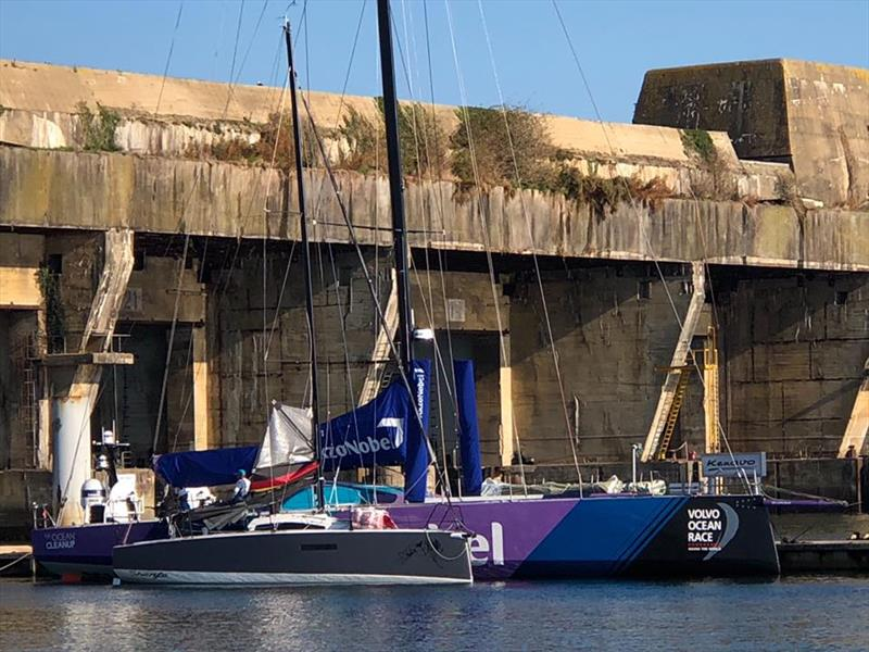 L30, a 30-foot one design keelboat, is dwarfed by a VO65 berthed in Lorient. - photo © L30class.org
