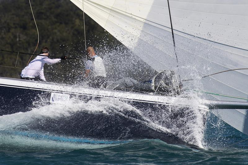 No problems about getting wet when you are in the tropics. On the bow of the R/P66, Alive. 2018 Airlie Beach Race Week. - photo © Andrea Francolini