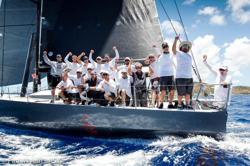 A victorious Warrior crew at the finish of the 2018 Peters & May Round Antigua Race - photo © Paul Wyeth