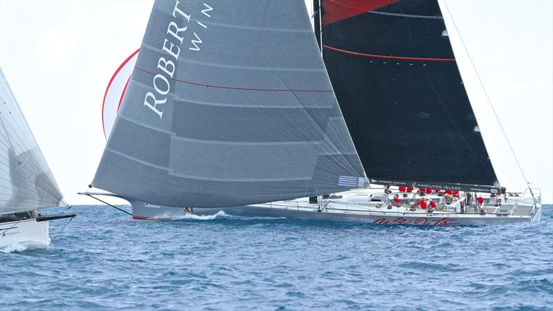 A contrast in bowsprits as Wild Oats XI cuts back through the fleet - Hamilton Island Race Week - Day 6 - photo © Richard Gladwell