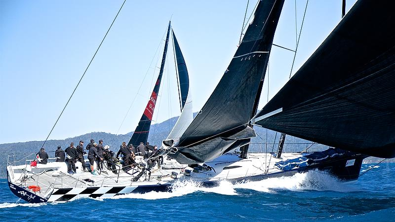 The supermaxi Black Jack sets up to leeward of Wild Oats XI - Hamilton Island Race Week - August - photo © Richard Gladwell