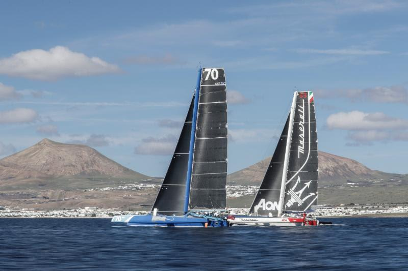 Enjoying a duel through the Canary Islands: Peter Cunningham's MOD70 PowerPlay and Giovanni Soldini's Multi 70 Maserati RORC Transatlantic Race - photo © Mikel Prieto