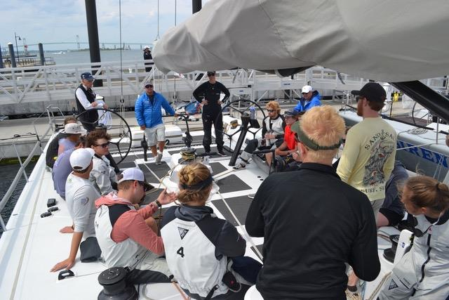 YASA coaches Peter Becker (starboard wheel), Ralfie Steitz (blue jacket) and Sara Hastreiter, (all black at port wheel) conduct a debriefing aboard RP 63 Gambler, prior to the Newport to Bermuda Race June 2018 - photo © Joe Cooper/YASA