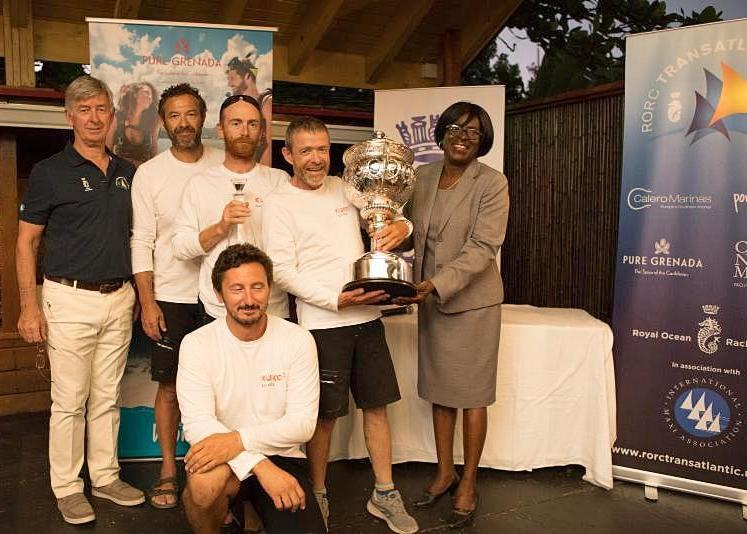 Grenadian Minister for Tourism & Civil Aviation, Dr. Clarice Modeste-Curwen, M.P. presents Franco Niggeler and some of his Cookson 50 Kuka3 crew with the magnificent RORC Transatlantic Race Trophy at the prize giving photo copyright Arthur Daniel / RORC taken at  and featuring the IRC class