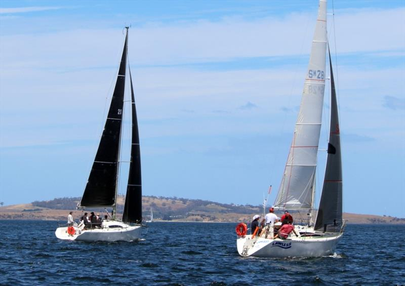 King of the Derwent winner, Lawless, and another yacht pace it out to windward in light airs - photo © Peter Watson
