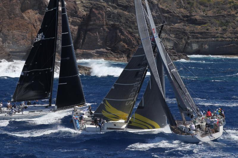 Ocean Racers, the Canadian Pogo 12.50 Hermes, co-skippered by Meg Reilly and Morgen Watson is seen here at the start of the RORC Caribbean 600 under the Pillars of Hercules, Antigua  - photo © Tim Wright / Photoaction.com