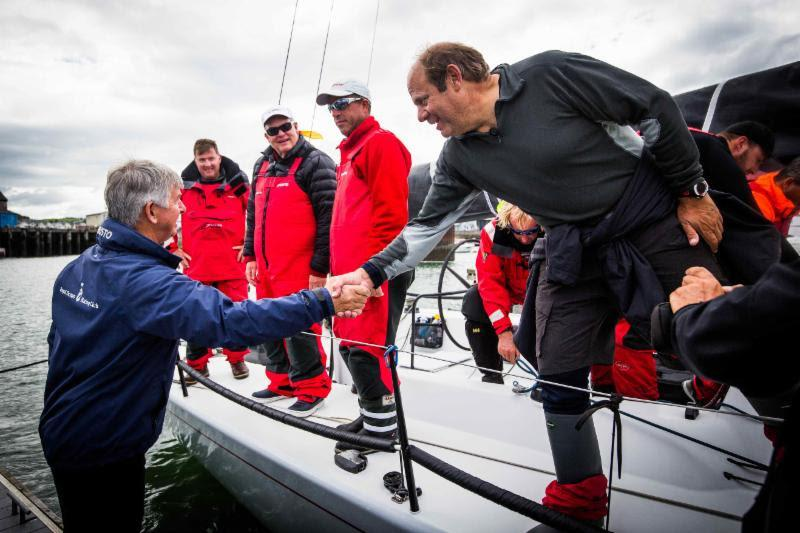 RORC CEO Eddie Warden Owen congratulates Ron O'Hanley and team on Privateer in the 2017 Rolex Fastnet Race - photo © ELWJ Photography