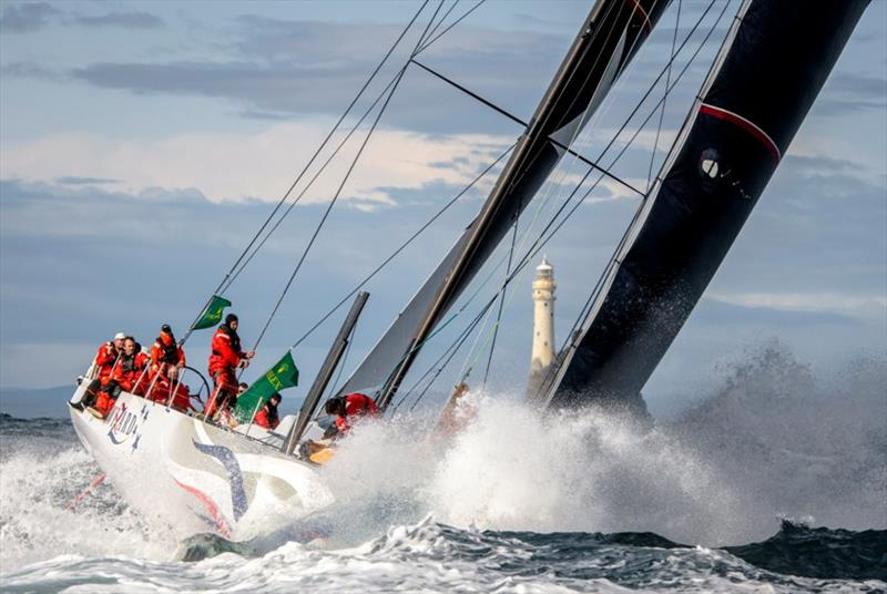 The American yacht Wizard passes the Fastnet Rock on the second day of the 2019 Rolex Fastnet Race. - photo © Rolex / Kurt Arrigo
