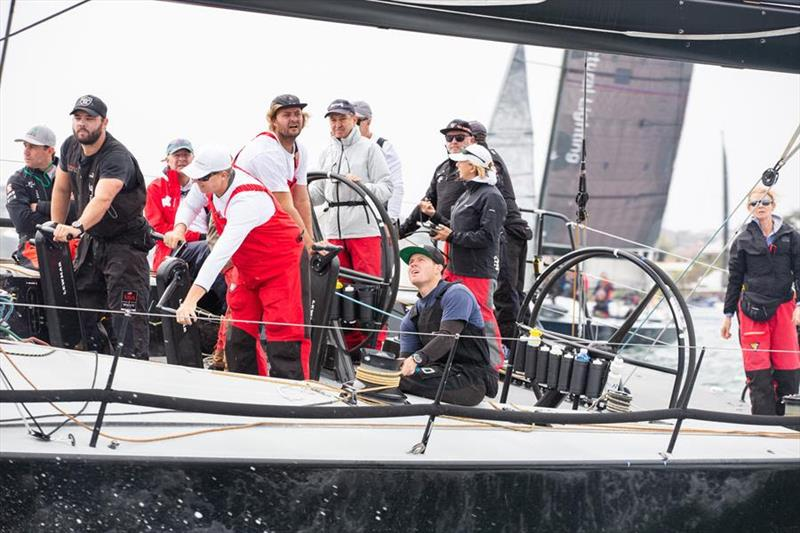 David Griffiths at the helm of Chinese Whisper as the team prepare for the race start. - photo © Hamish Hardy, CYCA Media