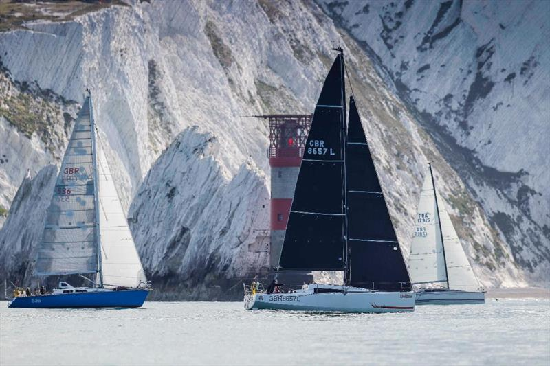 Yachts pass the Needles as they race round the Isle of Wight - photo © Paul Wyeth / pwpictures.com