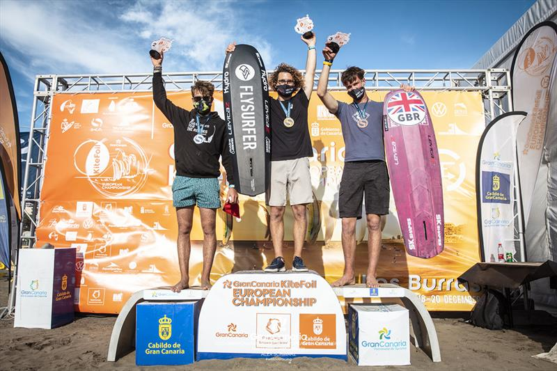 Overall podium (left to right): 2nd place-Maxime Nocher (FRA), 1st-Theo de Ramecourt (FRA), 3rd-Guy Bridge (GBR) - 2020 Gran Canaria KiteFoil Open European Championships photo copyright IKA Media / Alex Schwarz taken at  and featuring the Kiteboarding class