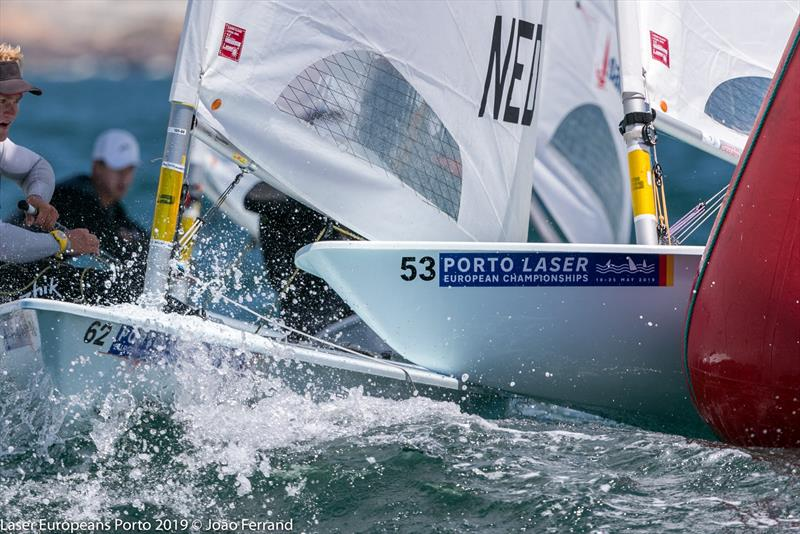 An Italian competitor finds a too small gap at the windward mark - Day 2 -  European Laser Championships - Porto - May 21, 2019 - photo ©  Joao Ferrand - Fotografia