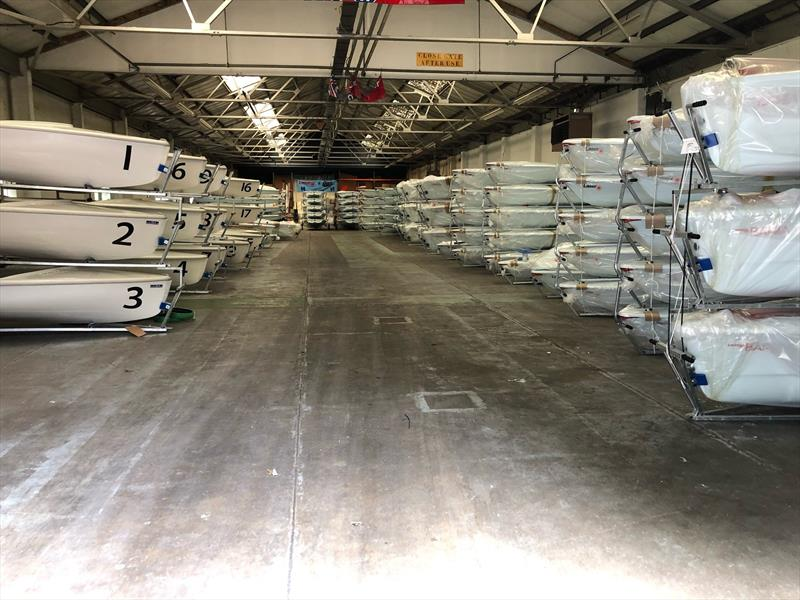 Lasers (on the right rear) stacked and waiting for competitors at the Youth Worlds in Poland. LPE and the other two builders supply boats on a charter basis for major Laser regattas - photo © Laser Performance Europe