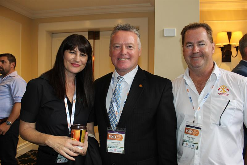 Member for Cairns, Michael Healy with Jo Drake for teh Superyacht Group Great Barrier Reef and Mark Ridell of Suouthport Yacht Club - 2019 Asmex - Day 1 photo copyright Kylie Pike taken at  and featuring the Marine Industry class