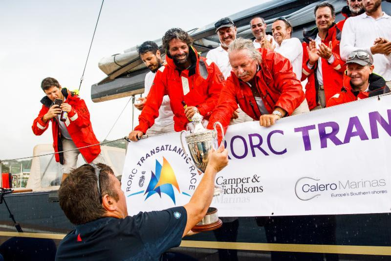 RORC Race Officer Steve Cole presents the IMA Trophy for Monohull Line Honours in the RORC Transatlantic Race - photo © RORC / Arthur Daniel