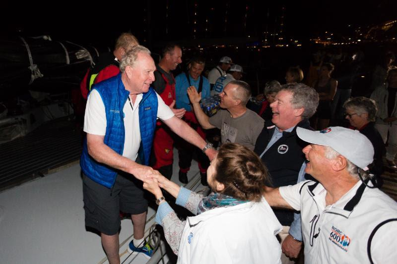 George David and Rambler 88 team is congratulated on the dock in Antigua - photo © RORC / Arthur Daniel